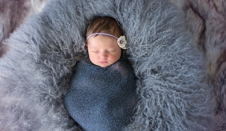 A professional photo of a newborn baby girl