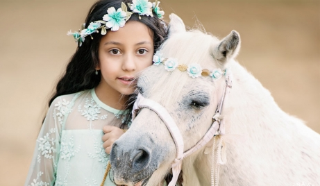 A portrait of a girl with a pony