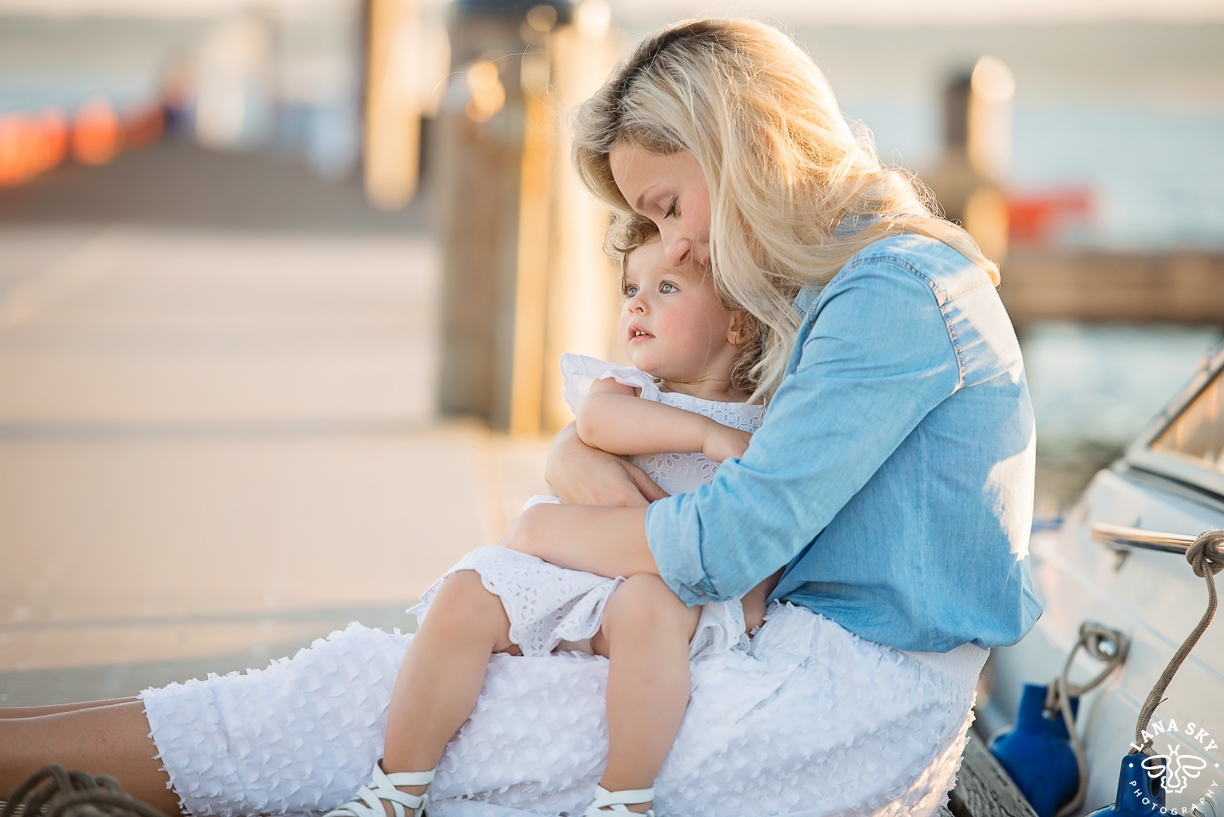 A portrait of a mom hugging her daughter in Kirkland, WA