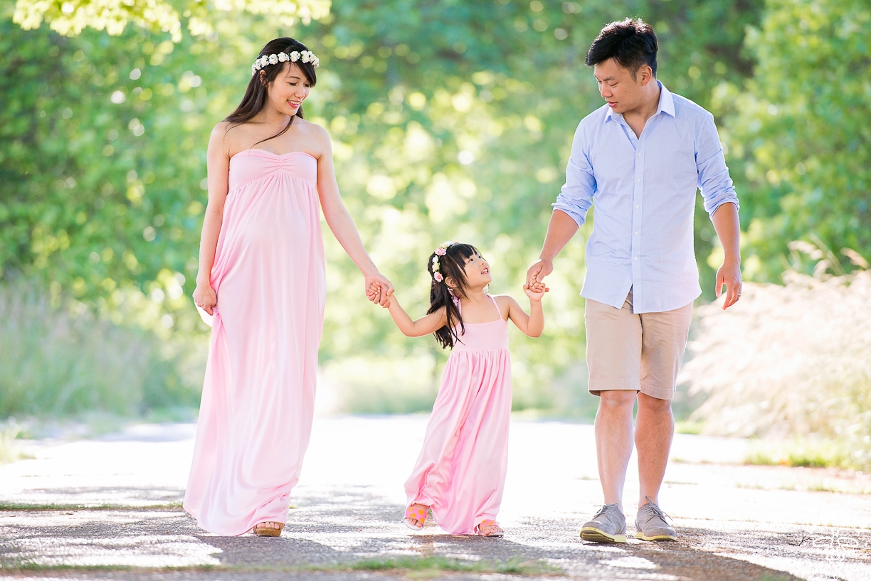 A professional maternity portrait of a family in a Seattle park