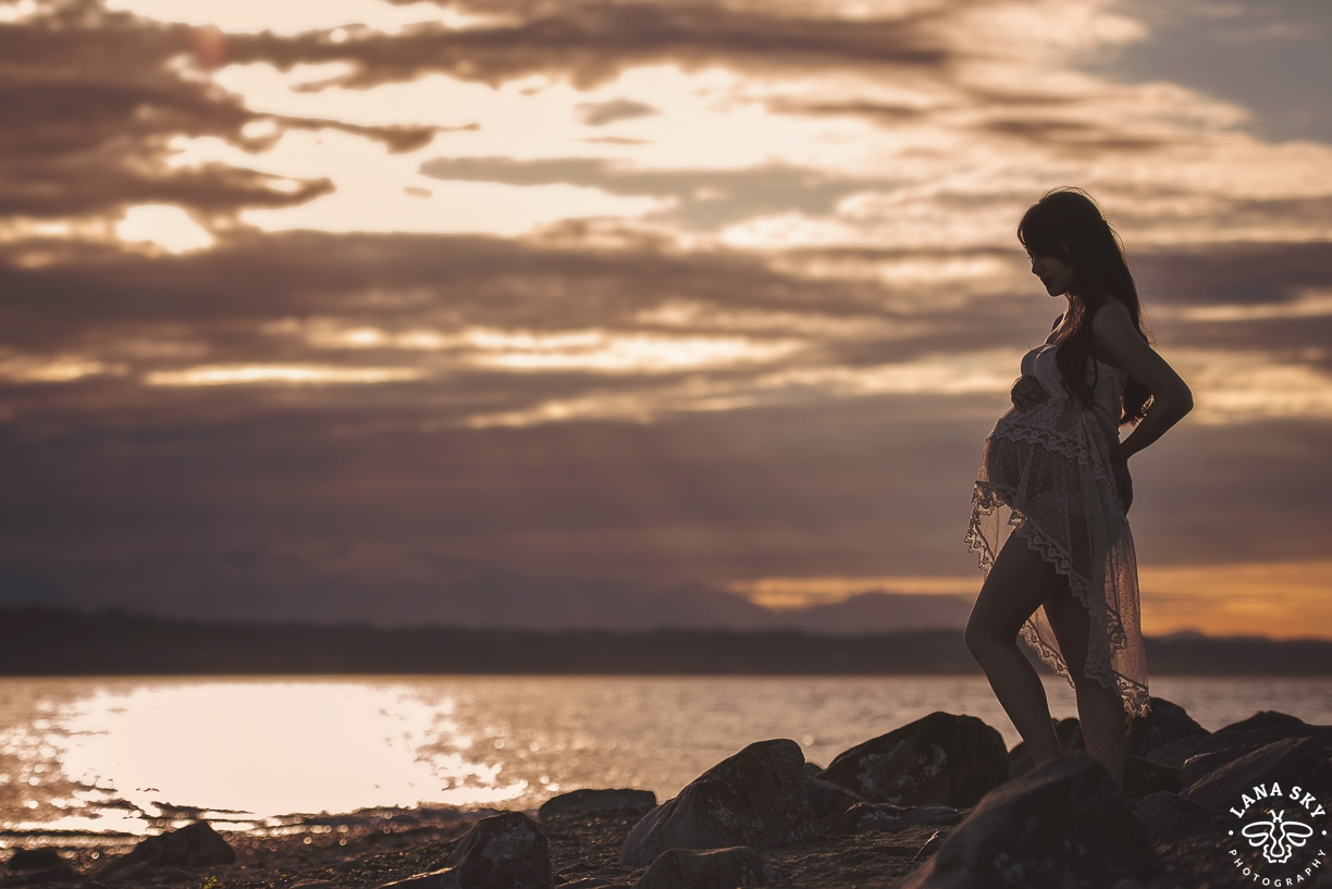 A professional maternity portrait during a sunset on a Beach in Seattle