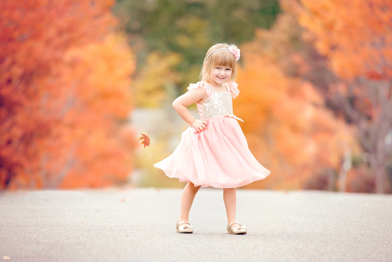 A fall portrait of a girl in a beautiful dress